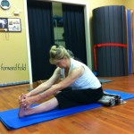 Randy in a seated forward fold (Padangushthasana)